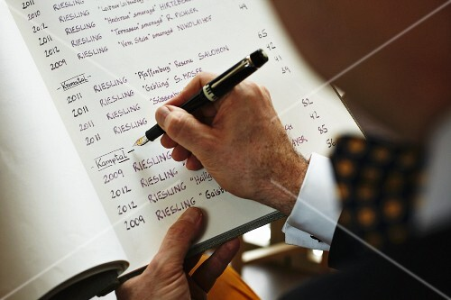 A sommelier writing a wine list