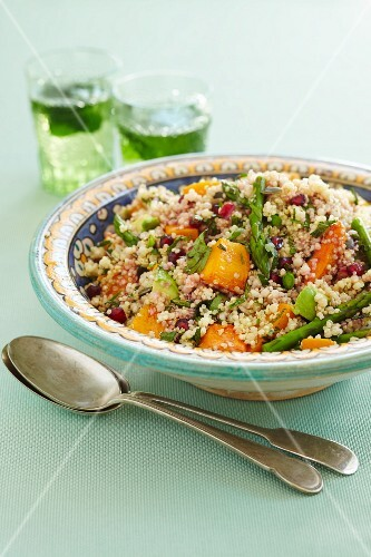 Couscous with sweet potatoes, green asparagus and pomegranate seeds