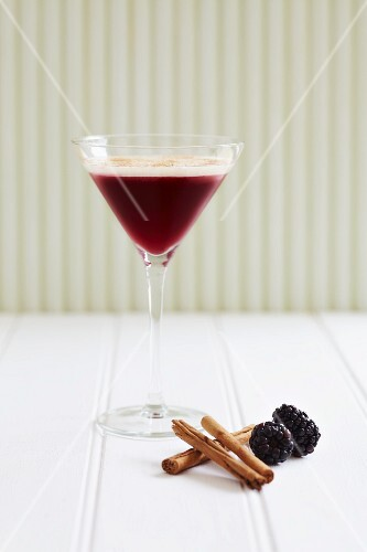 Blackcurrant and cinnamon drink in a Martini glass