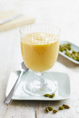 Orange and cardamom milk pudding in a dessert glass
