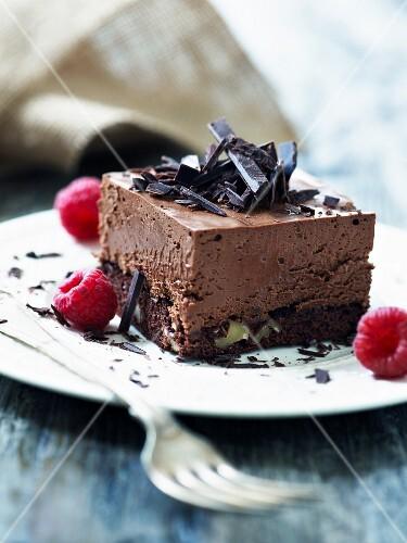 A chocolate slice with raspberries