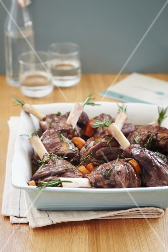 Roasted lamb shanks with rosemary, thyme and carrots