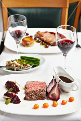 Pork steak with red wine pears
