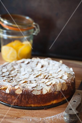 Lemon ricotta cake with almonds and icing sugar