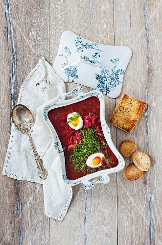 Borscht with chicken, egg and grilled bread