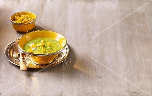 Cream of pea soup with saffron croutons