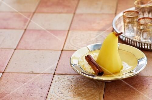 A poached saffron pear