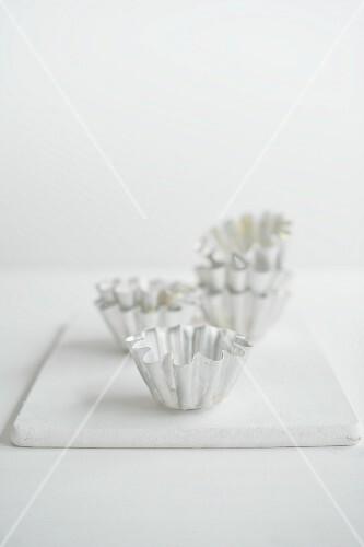 Brioche tins on a white chopping board
