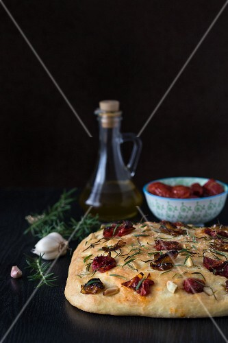 Focaccia with dried tomatoes, garlic, rosemary and olive oil