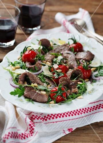 Beef steak on a rocket salad and Parmesan