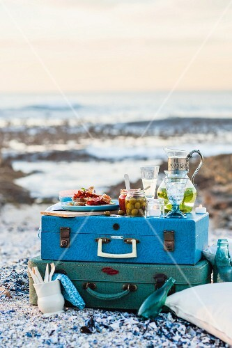 A picnic on a suitcase on a beach