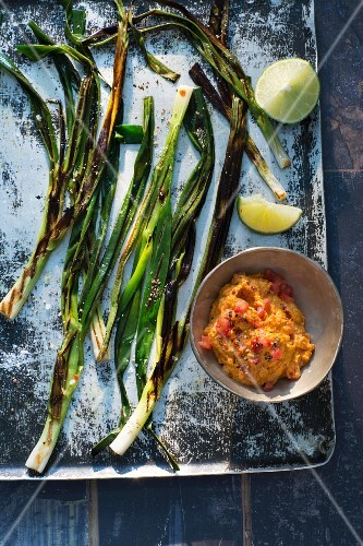 Grilled spring onions with a dip