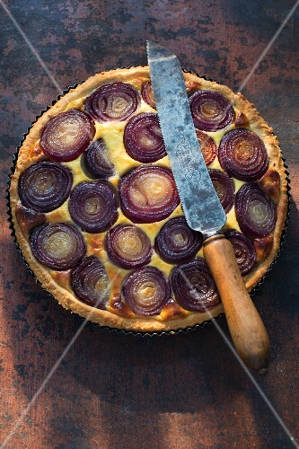 Red onion quiche in a baking tin