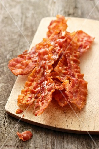 Crispy fried bacon on a chopping board