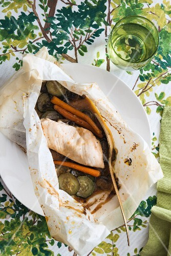 Chicken with courgette and carrots in parchment paper