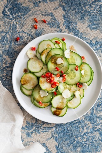 Courgette and cucumber salad with garlic and chilli rings