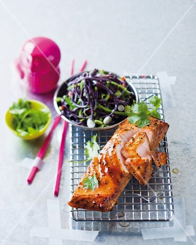 Tea-smoked salmon steaks with black noodles