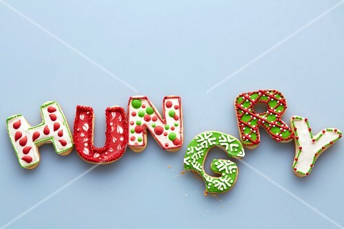 Letter-shaped Christmas biscuits spelling the word 'Hungry' with a bite taken out of the letter G
