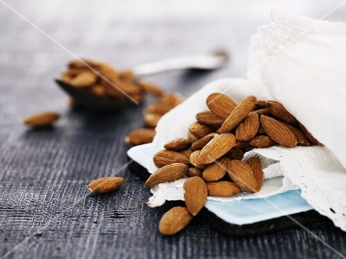 Almonds on a cloth and a spoon