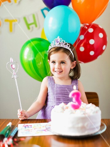 A little girl at a birthday party