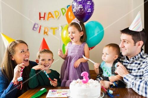 Family with three children celebrating a birthday