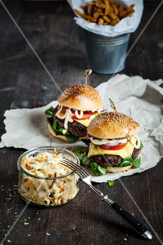 Homemade cheeseburgers with coleslaw and chips