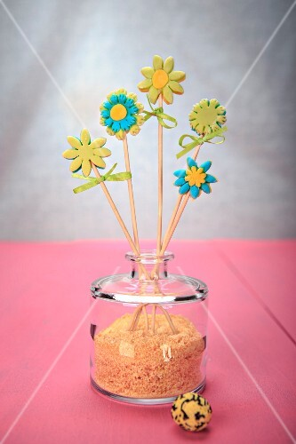 An arrangement of fondant flowers on sticks
