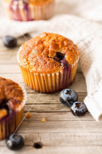 Birch sugar and blueberry muffins on a wooden surface