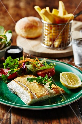 Barramundi fillet with salad and chips