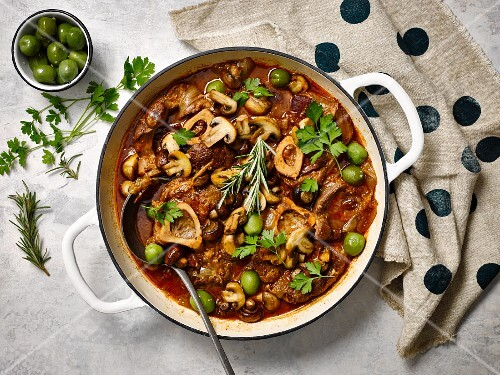 Beef ossobuco with red wine, mushrooms and olives