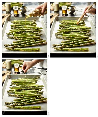 Organic asparagus with olive oil and sea salt being prepared for roasting