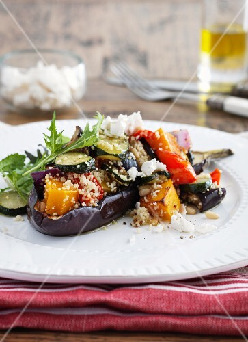 Stuffed aubergines with vegetables, couscous and sheep's cheese