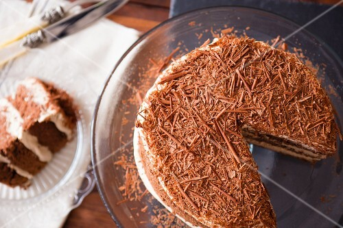 Mocha cake with grated chocolate, sliced