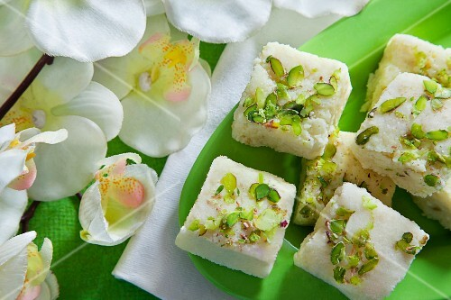 Kalakand with pistachios (sweets made from cream cheese and milk, India)