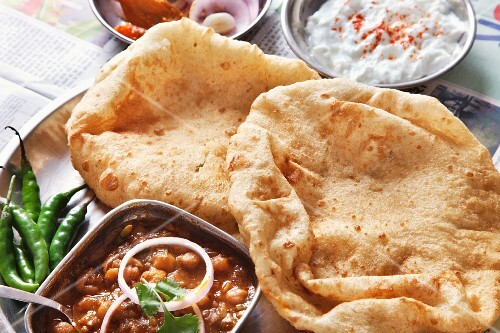 Chole bhatura (fried bread with a spicy chickpea sauce, India)