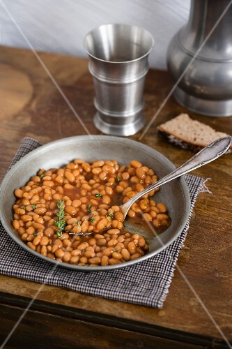 Baked beans on a pewter plate
