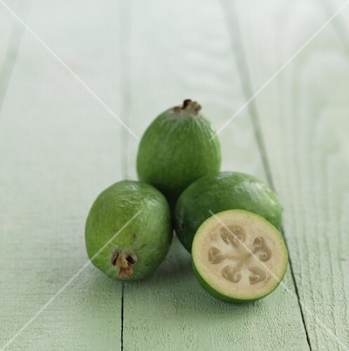 Guavas on a wooden surface