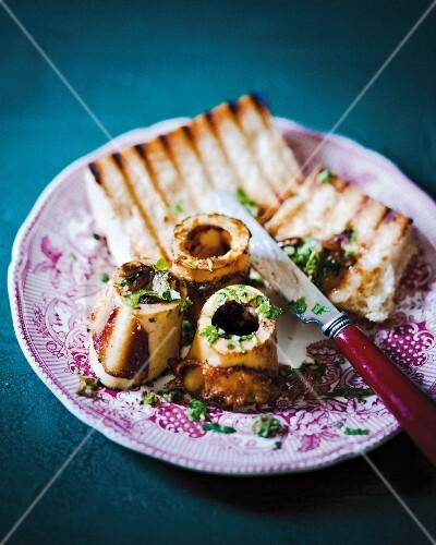 Roasted bone marrow with toast on a plate