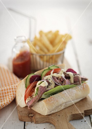Sandwich with beef, mayonnaise, tomatoes and cucumbers