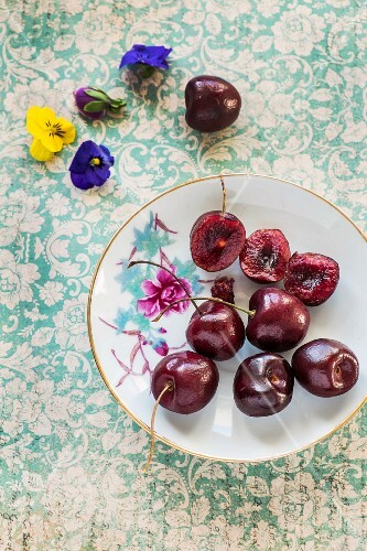 Fresh cherries on an old plate