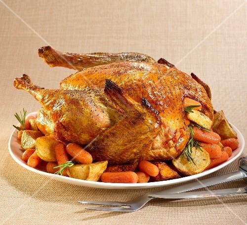 Roast turkey with rosemary, carrots and potatoes