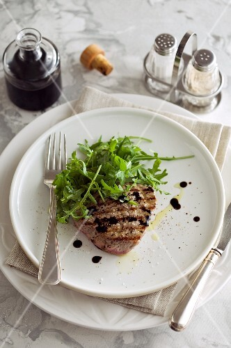 Beef steak with a rocket salad and balsamic dressing