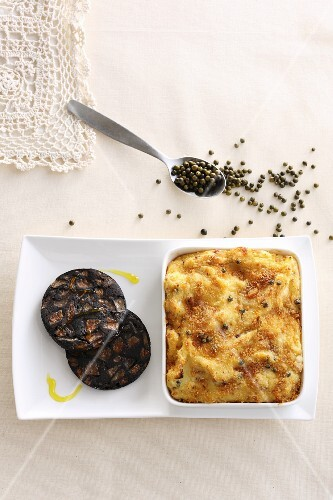 Potato and apple bake served with fried black pudding