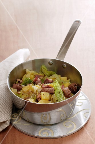 Potato stew with onions, apple, Chinese cabbage and pork