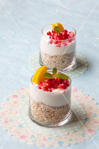 Gilbert muesli with pomegranate seeds and apples
