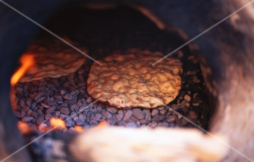 Unleavened bread in an oven (Morocco)