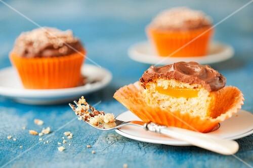 Cupcakes with orange jelly and chocolate ganache