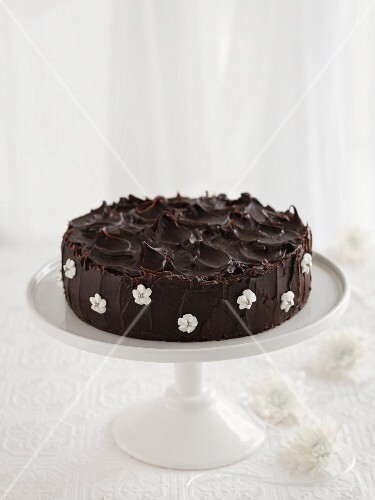 Chocolate cake with sugar flowers on a cake stand