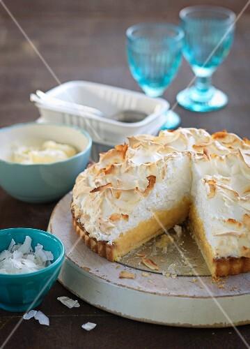 Citrus fruit meringue pie with grated coconut