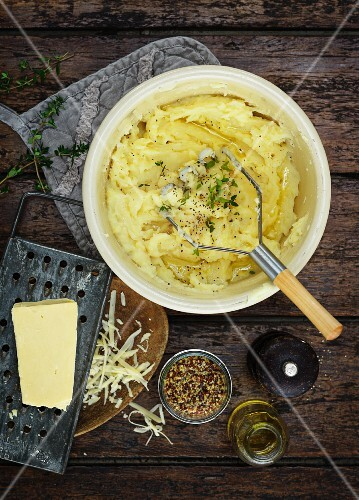 Mashed potatoes, butter, grated cheese, spices and olive oil
